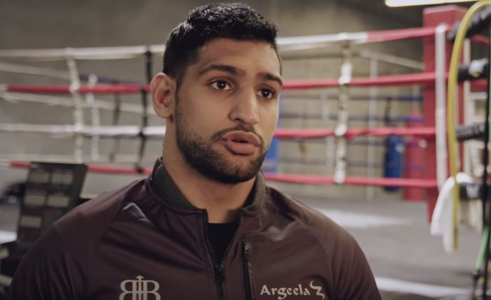 Amir Khan apologises to fans for inactivity, vows to return