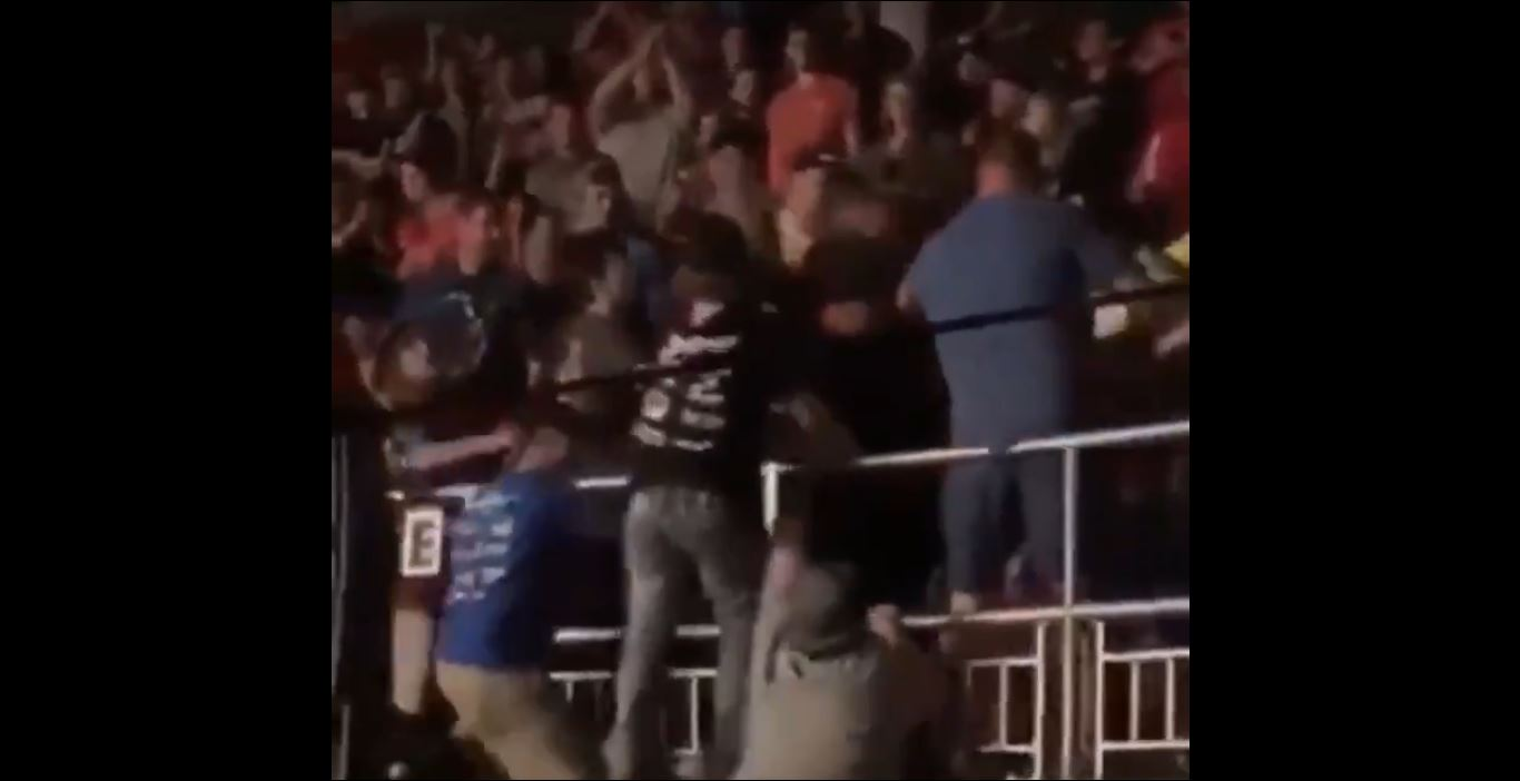Video Shows Fight Fan Nearly Thrown Off A Balcony In Shocking Event
